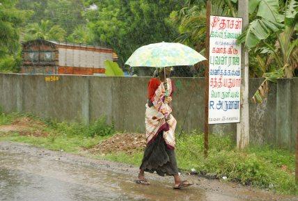 Old woman in the rain.