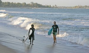 The old and the newbie surfers share the waves.