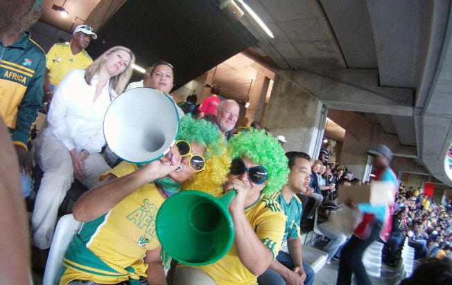 Bafana fans working their Vuvuzelas.
