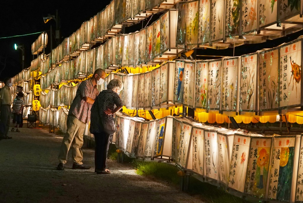 A couple inspect the handmade lanterns